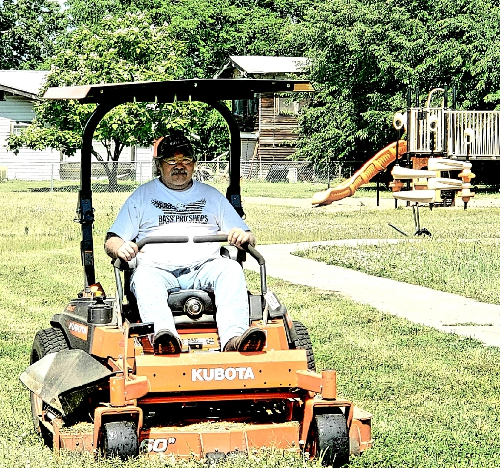 Art Cline working to keep the grounds nice at the elementary.